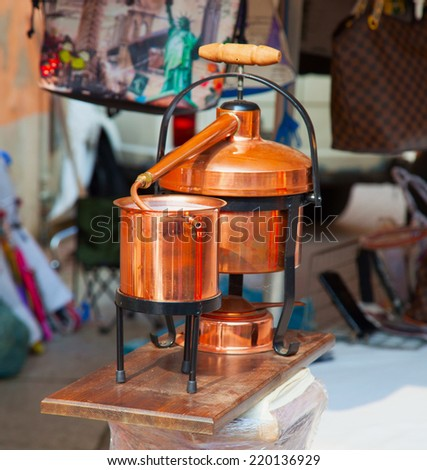 Bronze still for grappa, in close up - stock photo