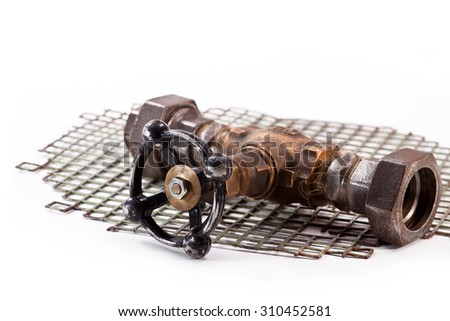 Bronze tap water and an iron grid on a white background - stock photo