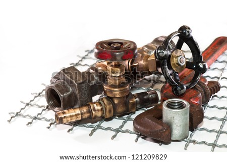 Bronze water taps, pipe wrench with a socket and iron bars on a white background - stock photo