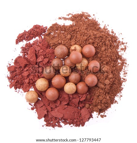 bronzing pearls with crushed eyeshadows isolated on white background