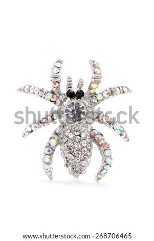 brooch in the form of a spider on a white background - stock photo