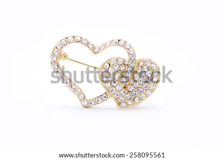 brooch in the form of heart on a white background - stock photo