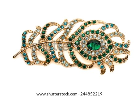 Brooch in the shape of peacock feather. Isolate on white. - stock photo