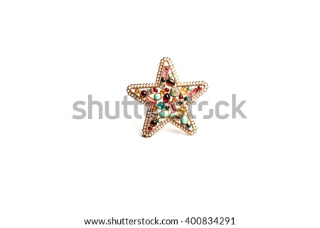 brooch star made of wire and beads - stock photo