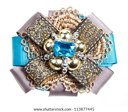 Brooch with beads, silk ribbons, knitting detail. Handmade - stock photo