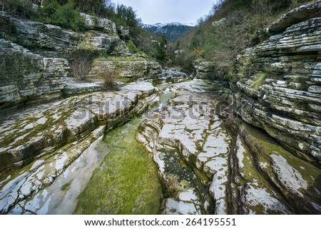 Brook of Ovires (Kolymbithres), Papigo village, Zagorochoria. A picturesque natural swimming pool, with nice formation of the rocks. - stock photo