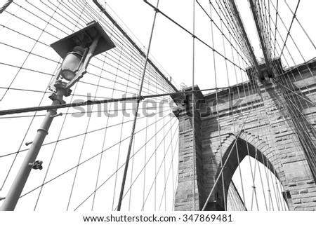 Brooklyn Bridge against sky black and white, New York City, USA  - stock photo