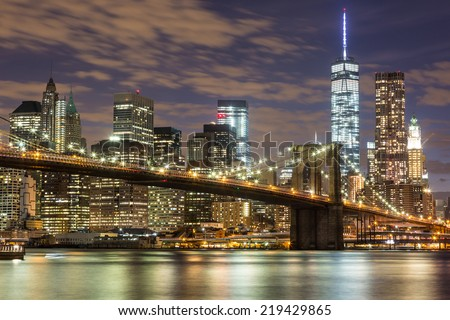 Brooklyn Bridge and Downtown Skyscrapers in New York at Night - stock photo