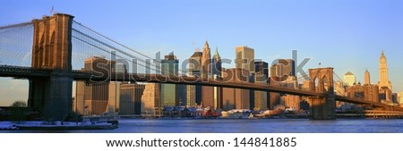 Brooklyn Bridge and East River at sunrise with New York City skyline, NY