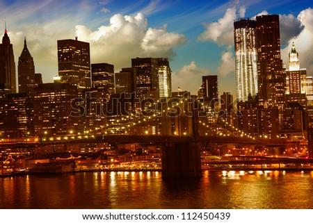 Brooklyn Bridge and Lower Manhattan Skyline at Sunset, view from Manhattan Bridge - stock photo