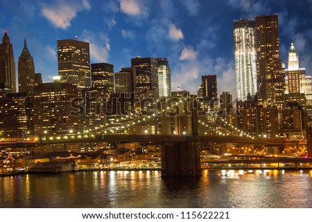 Brooklyn Bridge and Lower Manhattan Skyline at Sunset, view from Manhattan Bridge - stock photo