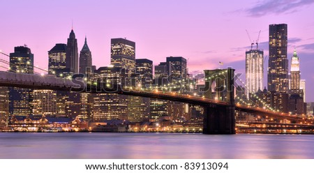 Brooklyn Bridge and Lower Manhattan skyline in New York City. - stock photo