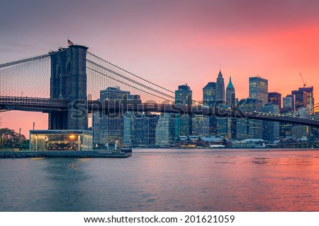 Brooklyn bridge and Manhattan at dusk, New York City - stock photo