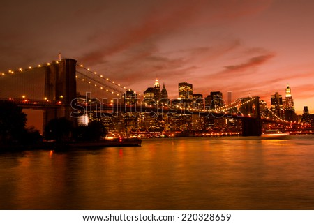 Brooklyn Bridge and Manhattan at sunset, New York, orange tone