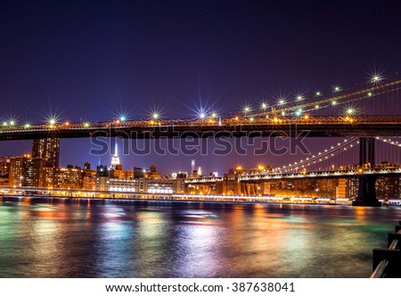 Brooklyn Bridge and Manhattan Bridge spanning the East River towards Manhattan in New York City - stock photo