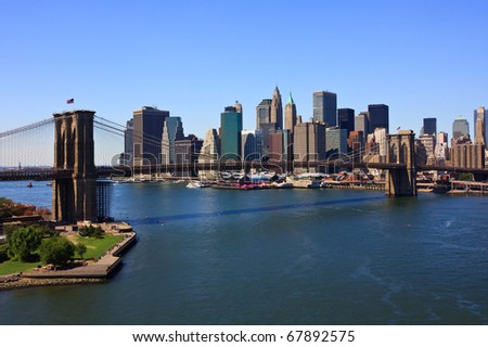 Brooklyn Bridge and Manhattan in New York City - stock photo