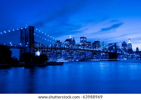 Brooklyn Bridge and Manhattan, New York. Blue tint - stock photo