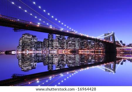 Brooklyn Bridge and Manhattan skyline At Night - stock photo