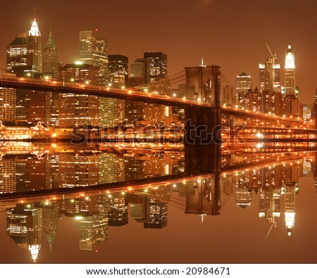 Brooklyn Bridge and Manhattan skyline At Night - stock photo