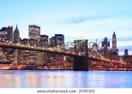 Brooklyn Bridge and Manhattan skyline At Night, New York City - stock photo