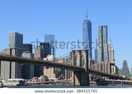 Brooklyn Bridge and Manhattan Skyline on a clear blue day, New York City - stock photo