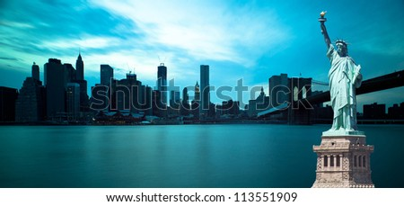 Brooklyn Bridge and Manhattan Skyline with the Statue of Liberty, New york City. - stock photo