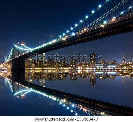 Brooklyn Bridge and Manhattan with reflections. Night scene - stock photo