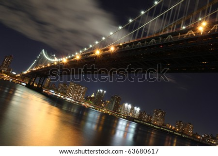 Brooklyn Bridge and New York City - stock photo