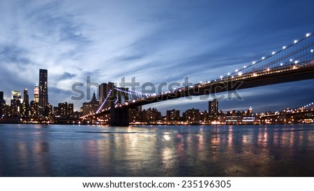 Brooklyn Bridge and New York skyline at sunset
