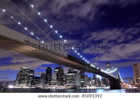 Brooklyn Bridge and Skyline At Night, New York City - stock photo