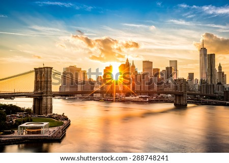 Brooklyn Bridge and the Lower Manhattan skyline at sunset, as viewed from Manhattan Bridge - stock photo