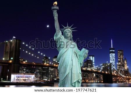 Brooklyn Bridge and The Statue of Liberty at Night, New York City - stock photo