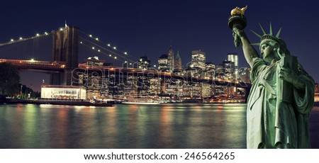 Brooklyn Bridge and The Statue of Liberty at Night, New York City - stock photo