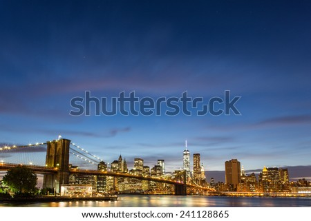 Brooklyn Bridge at dusk viewed from the Brooklyn Bridge Park in New York City - stock photo