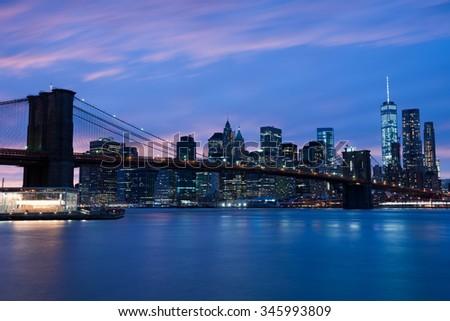 Brooklyn bridge at night, New York City - stock photo