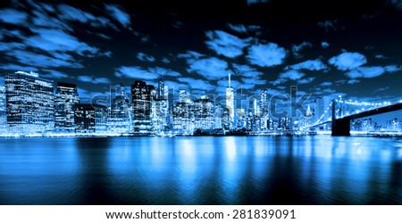 Brooklyn Bridge at night with Lower Manhattan blue filter - stock photo