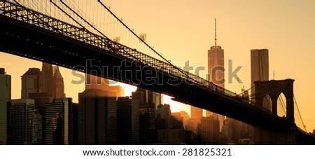 Brooklyn bridge at sunset, New York City - stock photo