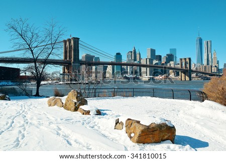 Brooklyn Bridge closeup with snow in winter in New York City - stock photo