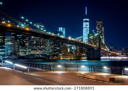 Brooklyn Bridge, Downtown Manhattan, New York. Night scene. Light trails. City lights. Urban living and transportation concept - stock photo