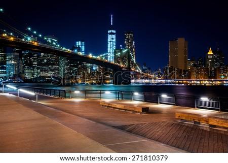 Brooklyn Bridge, Downtown Manhattan, New York. Night scene. Light trails. City lights. Urban living and transportation concept - stock photo