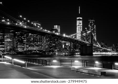 Brooklyn Bridge, Downtown Manhattan, New York. Night scene. Light trails. City lights. Urban living and transportation concept. Monochrome, black and white post processed - stock photo