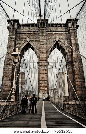 Brooklyn bridge in cloudy day, New York - stock photo