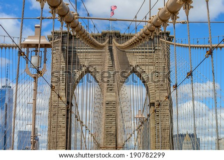 Brooklyn Bridge in Manhattan closeup with skyscrapers and city skyline over Hudson River. - stock photo