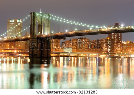 Brooklyn bridge in New York at night - stock photo