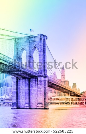 Brooklyn Bridge in New York City United States America.  Famous suspension bridge in NYC USA, it connects Manhattan and Brooklyn by spanning the East River. Image with rainbow colors filter effect