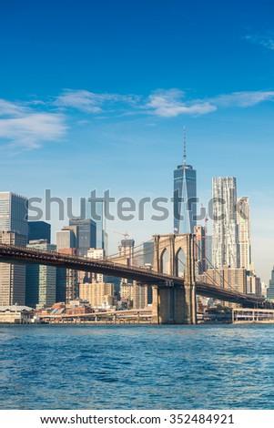 Brooklyn Bridge in New York on a sunny day. - stock photo