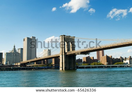 Brooklyn bridge in New York on bright summer day - stock photo