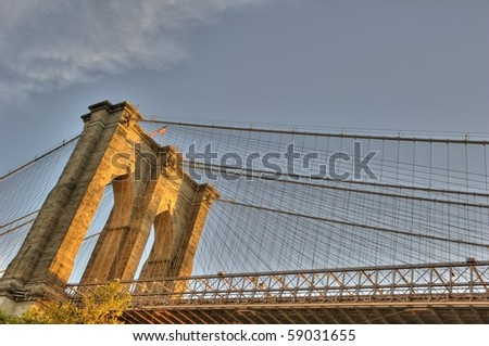 Brooklyn bridge in the golden light of the morning sun. HDR composite of three exposures