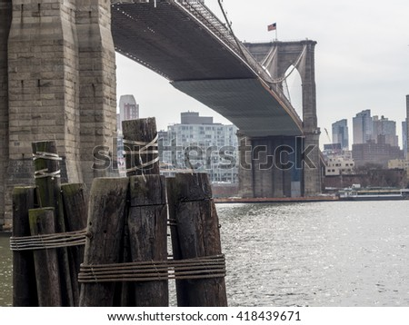 Brooklyn Bridge is a hybrid cable-stayed/suspension bridge in New York City under with pilings