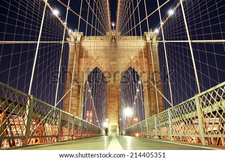 Brooklyn bridge lit up at night - stock photo